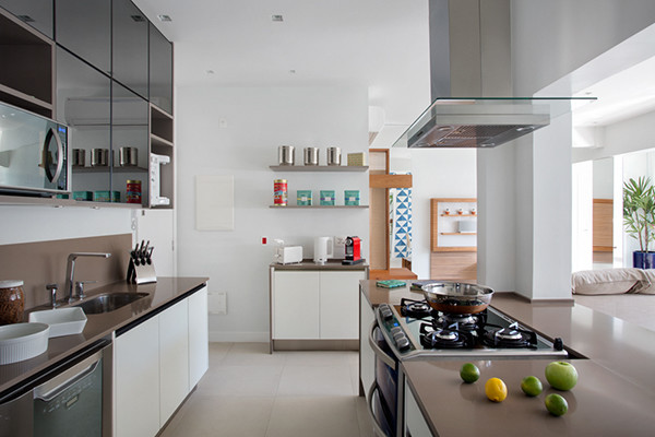 Example of a large trendy galley porcelain floor and beige floor eat-in kitchen design in Other with an undermount sink, flat-panel cabinets, white cabinets, quartzite countertops, brown backsplash, stone slab backsplash, stainless steel appliances and an island