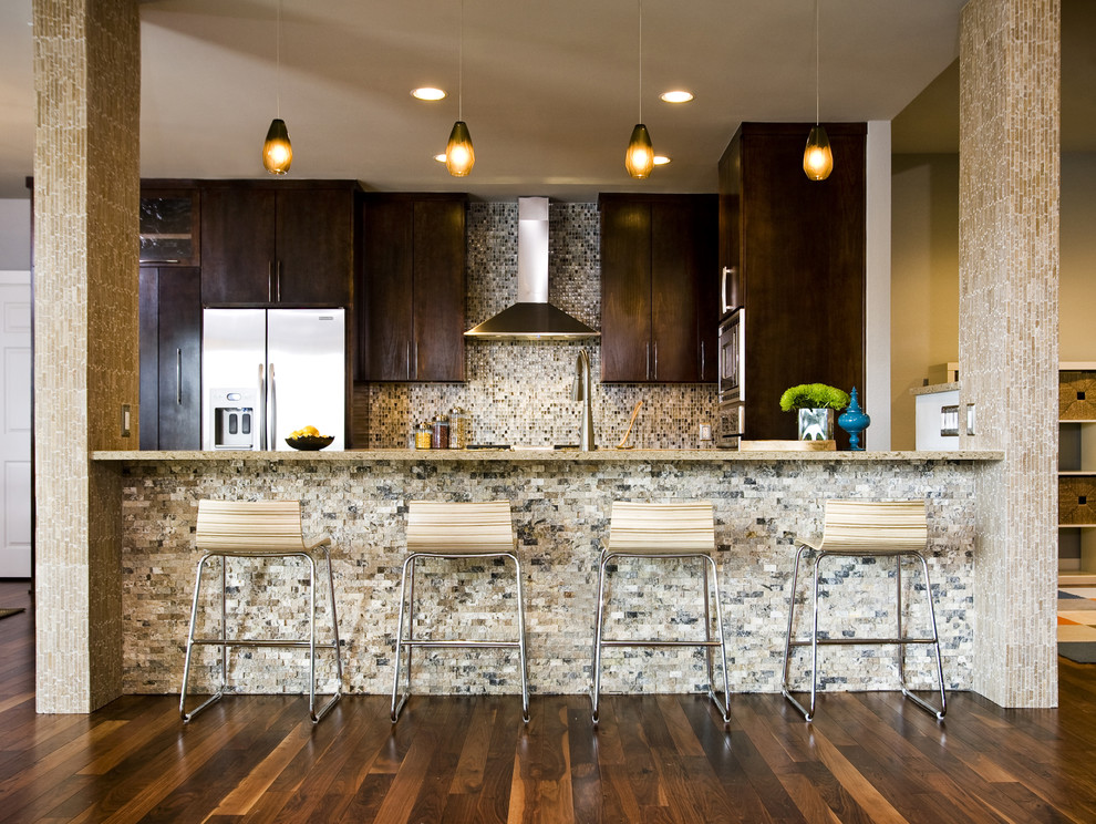 Eat-in kitchen - contemporary u-shaped eat-in kitchen idea in Austin with an undermount sink, flat-panel cabinets, dark wood cabinets, quartzite countertops, multicolored backsplash, mosaic tile backsplash and stainless steel appliances