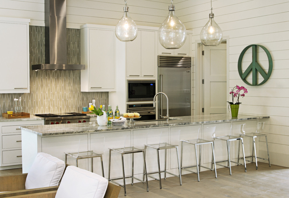 Example of a trendy galley kitchen design in Austin with gray backsplash and a peninsula