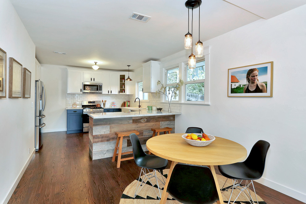 Transitional u-shaped eat-in kitchen photo in Los Angeles with recessed-panel cabinets, blue cabinets, white backsplash, subway tile backsplash and white appliances