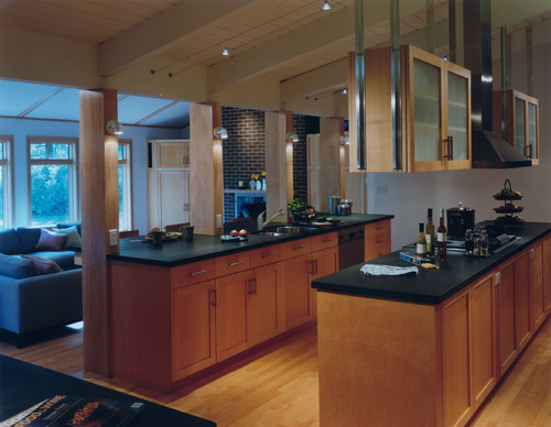 Black appliances with darker cabinets