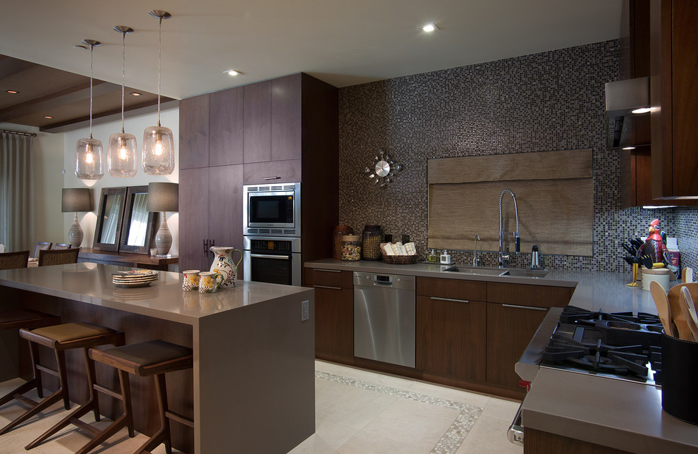 Eat-in kitchen - contemporary l-shaped eat-in kitchen idea in San Diego with a double-bowl sink, flat-panel cabinets, dark wood cabinets, gray backsplash, mosaic tile backsplash and stainless steel appliances