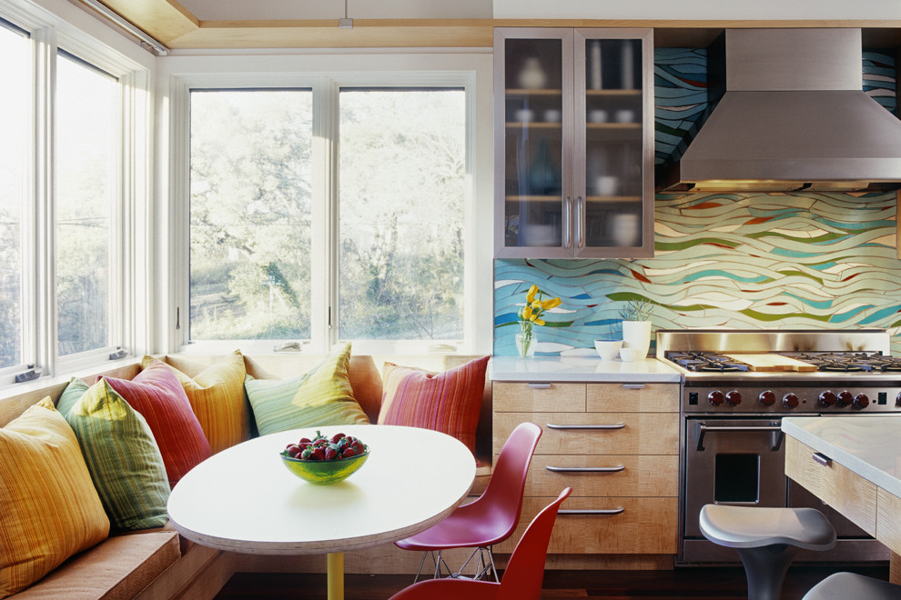 Trendy kitchen photo in Austin with stainless steel appliances, flat-panel cabinets, medium tone wood cabinets and multicolored backsplash