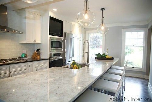 Colonial white granite countertops artistic granite for Kitchen cabinets 60007