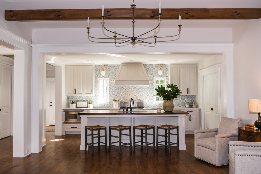 Example of a mid-sized country single-wall brown floor and medium tone wood floor eat-in kitchen design in Atlanta with gray cabinets, blue backsplash, terra-cotta backsplash, stainless steel appliances, an island, a drop-in sink, shaker cabinets and quartz countertops