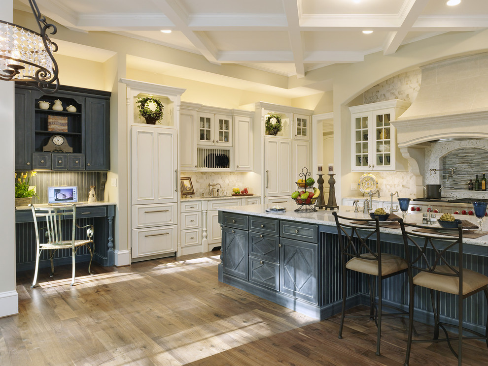 Example of a huge classic l-shaped dark wood floor and brown floor kitchen design in Baltimore with a farmhouse sink, beaded inset cabinets, white cabinets, granite countertops, beige backsplash, stone slab backsplash, stainless steel appliances and an island