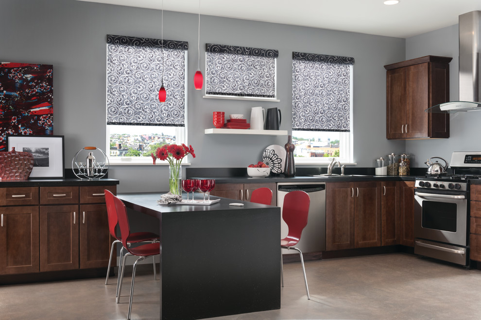 Large minimalist u-shaped concrete floor eat-in kitchen photo in New Orleans with a drop-in sink, shaker cabinets, medium tone wood cabinets, solid surface countertops, black backsplash, stone slab backsplash, stainless steel appliances and a peninsula