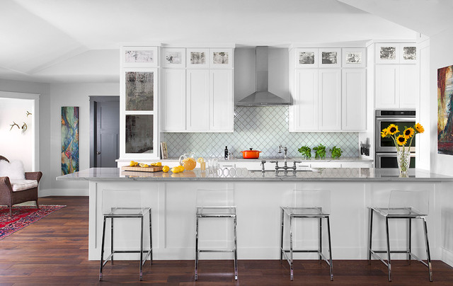 Transitional galley dark wood floor open concept kitchen photo in Austin with shaker cabinets, white cabinets, stainless steel appliances, an island and white backsplash