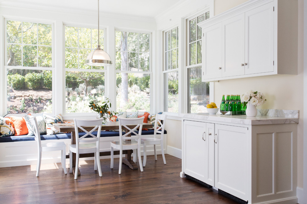 Elegant eat-in kitchen photo in San Francisco with marble countertops