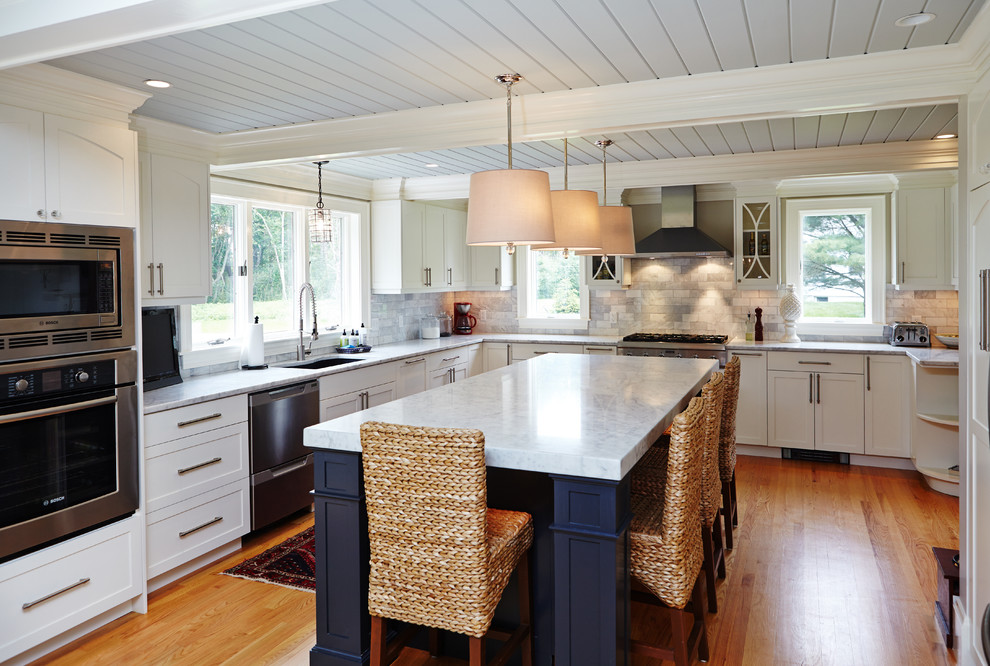 Example of a classic kitchen design in Portland Maine with stainless steel appliances