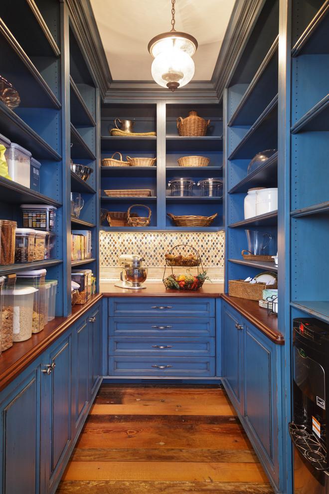 Elegant u-shaped medium tone wood floor kitchen pantry photo in Other with open cabinets, blue cabinets, wood countertops, multicolored backsplash and mosaic tile backsplash