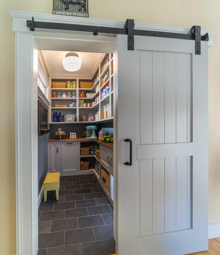 Example of a mid-sized cottage ceramic tile and gray floor kitchen pantry design in Boston with recessed-panel cabinets, gray cabinets and wood countertops