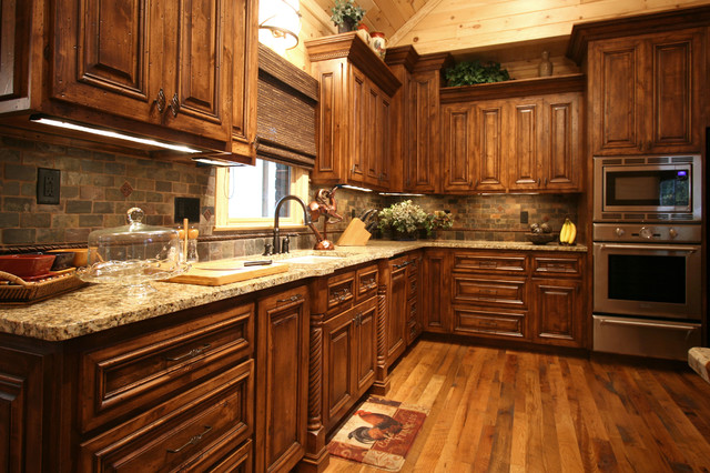 Rustic cabin style traditional kitchen charlotte for Log cabin kitchen backsplash ideas