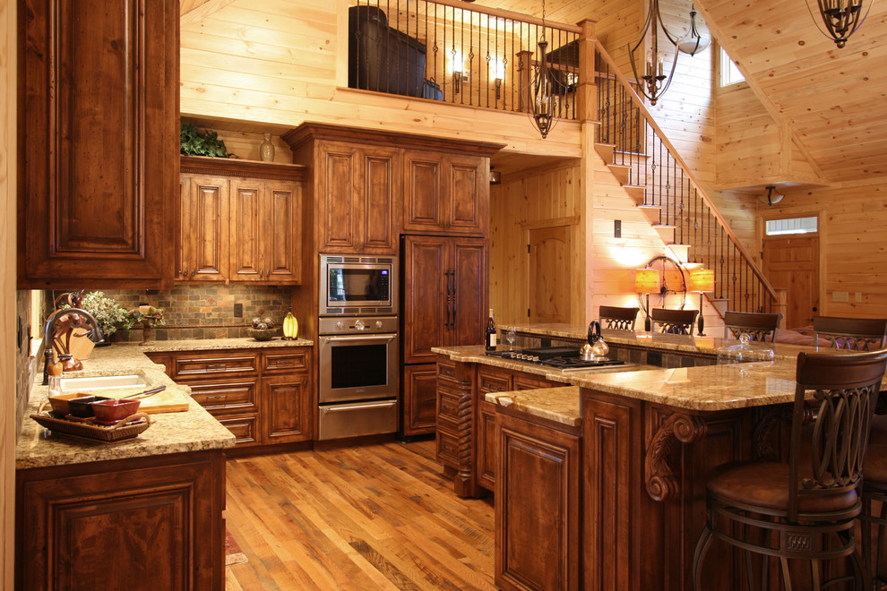 Example of a mountain style kitchen design in Charlotte with granite countertops and slate backsplash