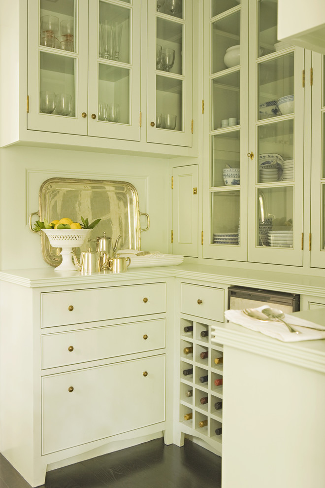 Transitional kitchen photo in Los Angeles with glass-front cabinets and white cabinets