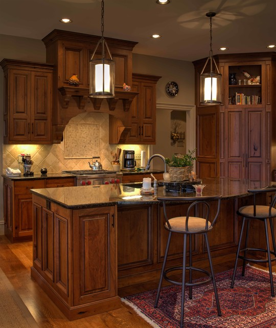rustic cherry inset cabinetry with stained and glazed finish
