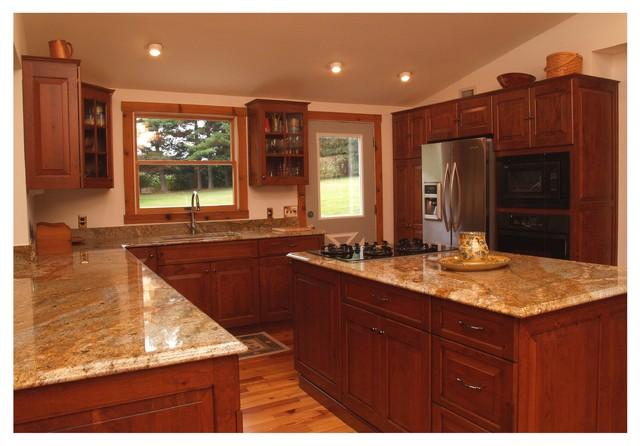 Rustic cherry kitchen with glass doors in columbia md for Cherry kitchen cabinets with glass doors