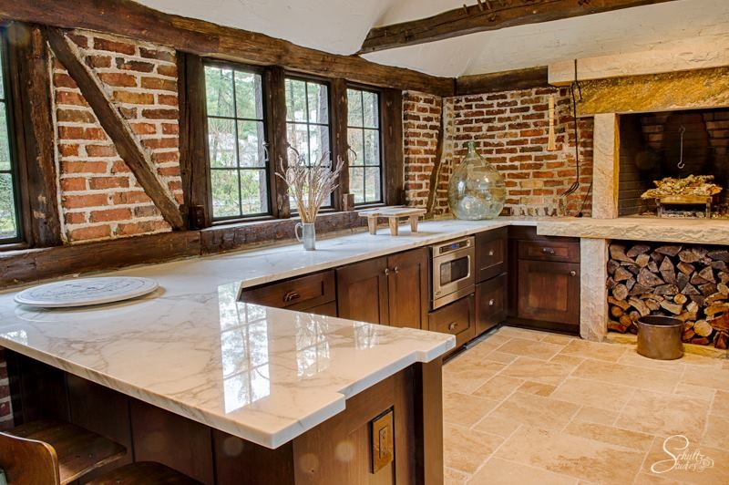 Inspiration for a large rustic u-shaped travertine floor eat-in kitchen remodel in Other with shaker cabinets, dark wood cabinets, marble countertops, red backsplash, stainless steel appliances and a peninsula