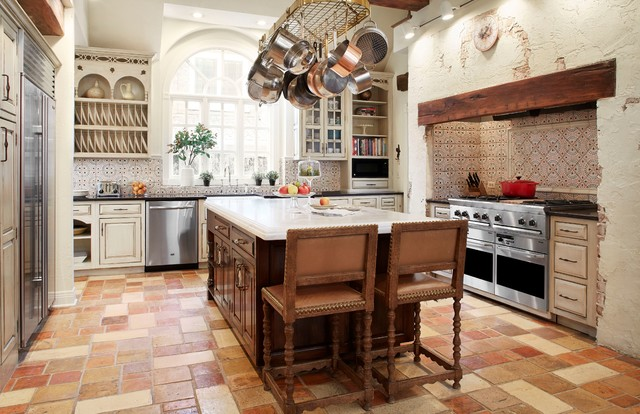 Farmhouse u-shaped enclosed kitchen photo in Chicago with raised-panel cabinets, beige cabinets, multicolored backsplash and stainless steel appliances