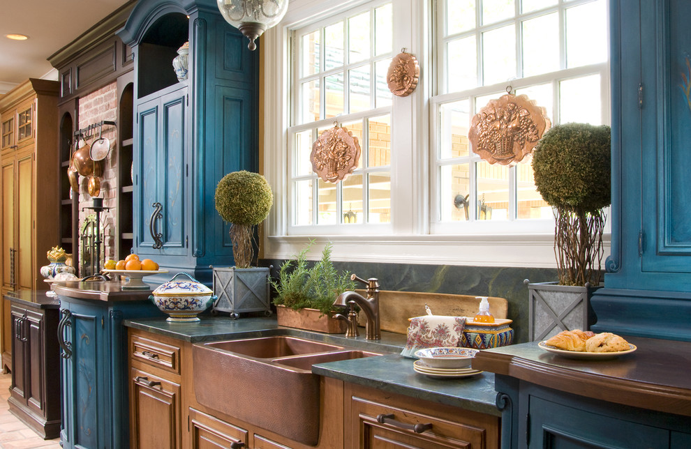 Inspiration for a cottage kitchen remodel in Indianapolis with a farmhouse sink, blue cabinets and granite countertops