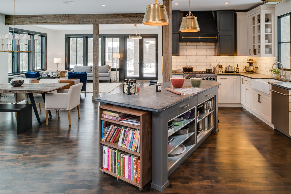 Example of a mountain style open concept kitchen design in Other with subway tile backsplash, a farmhouse sink, soapstone countertops, stainless steel appliances, white backsplash and gray cabinets