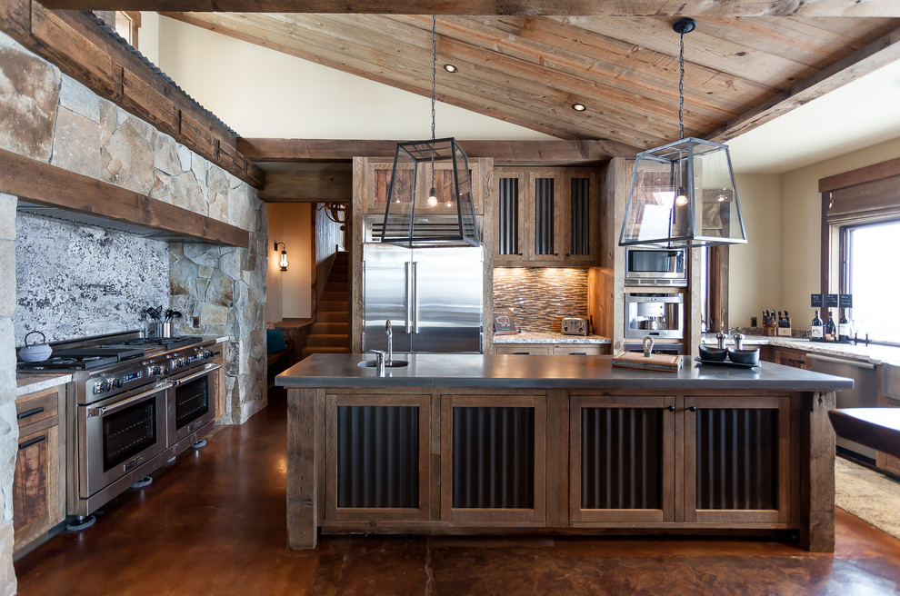 Example of a mountain style kitchen design in Sacramento with stone slab backsplash and an island