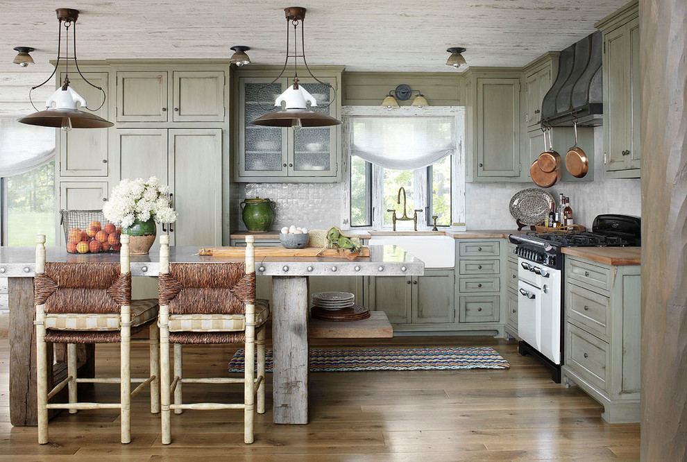 Inspiration for a rustic l-shaped kitchen remodel in Milwaukee with shaker cabinets, green cabinets, gray backsplash and white appliances