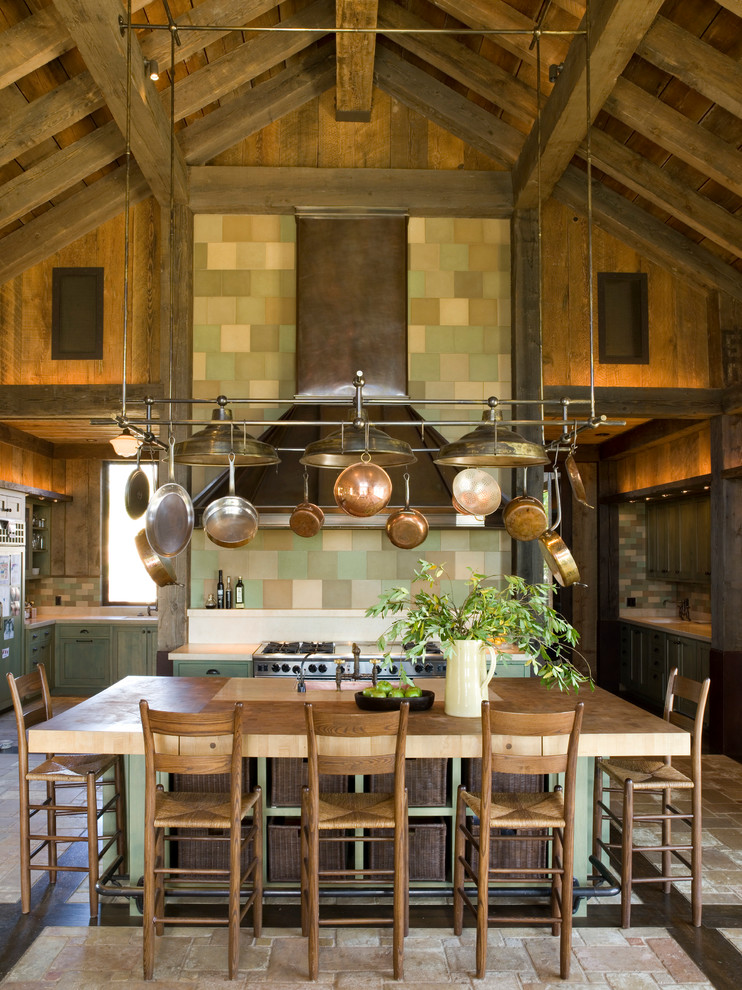 Mountain style kitchen photo in San Francisco with multicolored backsplash, mosaic tile backsplash, stainless steel appliances and an island