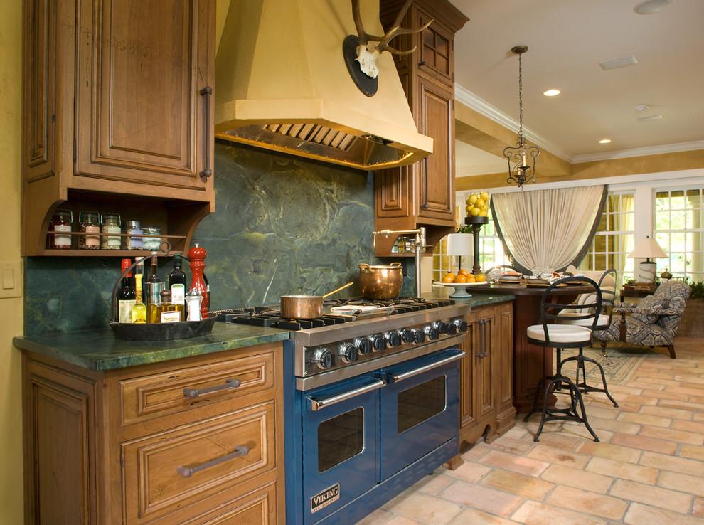Kitchen - farmhouse kitchen idea in Indianapolis with green backsplash, stone slab backsplash and colored appliances