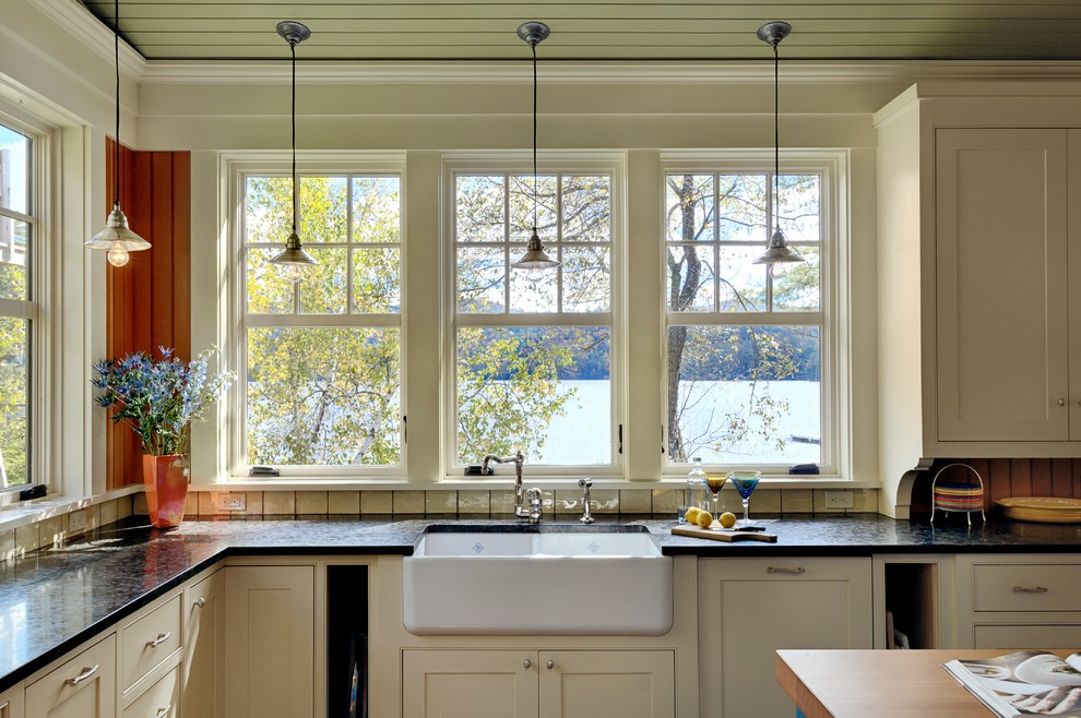 Inspiration for a rustic kitchen remodel in Burlington with a farmhouse sink, beaded inset cabinets and beige cabinets