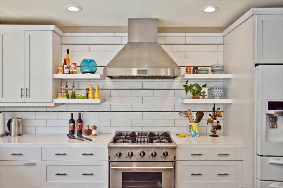 Trendy kitchen photo in San Diego with subway tile backsplash, white cabinets, white backsplash and stainless steel appliances