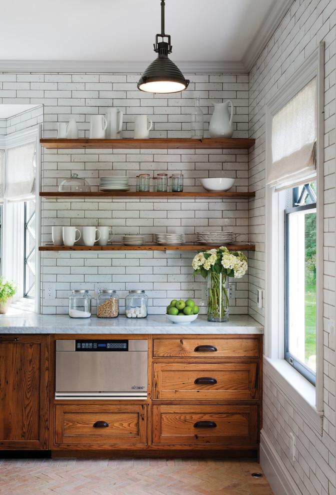 Kitchen - rustic kitchen idea in Burlington with recessed-panel cabinets, medium tone wood cabinets, granite countertops, white backsplash, subway tile backsplash and stainless steel appliances