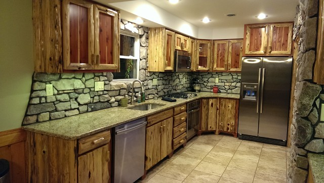 rustic red cedar kitchen with cultured stone backsplash