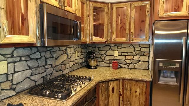 Rustic Red Cedar Kitchen with cultured Stone Backsplash ...