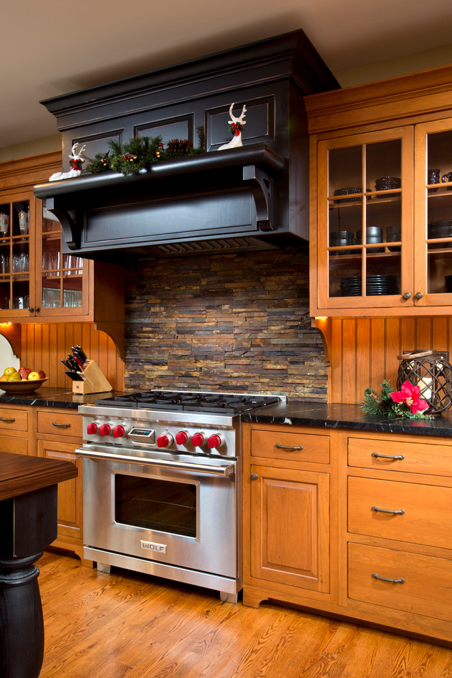 Inspiration for a timeless kitchen remodel in Boston with stainless steel appliances and slate backsplash
