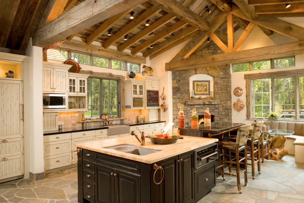 Inspiration for a timeless eat-in kitchen remodel in Other with a farmhouse sink, beige cabinets and an island