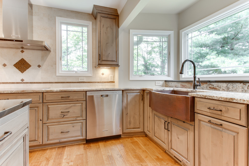 Inspiration for a rustic light wood floor and beige floor kitchen remodel in Raleigh with a farmhouse sink, raised-panel cabinets, light wood cabinets, stainless steel appliances, granite countertops, white backsplash and an island