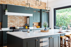 Dark Green Cabinets Add Elegance to a Welcoming Kitchen