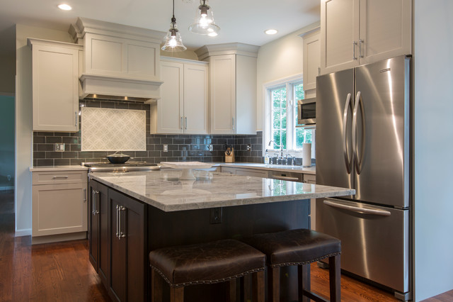 Eat-in kitchen - mid-sized transitional l-shaped medium tone wood floor eat-in kitchen idea in Bridgeport with an undermount sink, recessed-panel cabinets, gray cabinets, granite countertops, black backsplash, ceramic backsplash, stainless steel appliances and an island