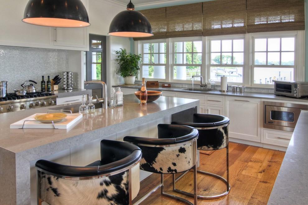 Kitchen - coastal kitchen idea in New York with an undermount sink, shaker cabinets, white cabinets, gray backsplash and mosaic tile backsplash