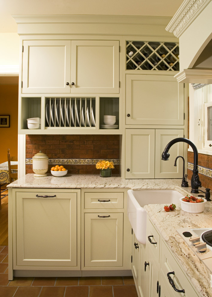 Inspiration for a timeless kitchen remodel in Seattle with a farmhouse sink, beaded inset cabinets, green cabinets, granite countertops, red backsplash and terra-cotta backsplash