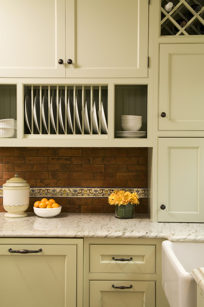 Example of a classic kitchen design in Seattle with beaded inset cabinets and beige cabinets