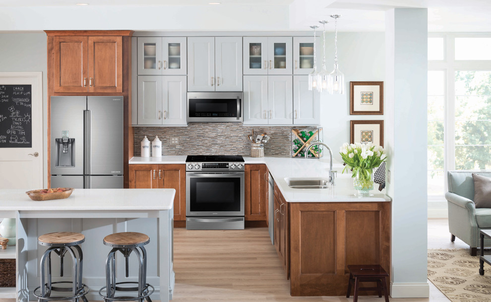 Inspiration for a mid-sized rustic l-shaped light wood floor open concept kitchen remodel in Vancouver with a double-bowl sink, beaded inset cabinets, gray cabinets, multicolored backsplash, matchstick tile backsplash, stainless steel appliances and an island