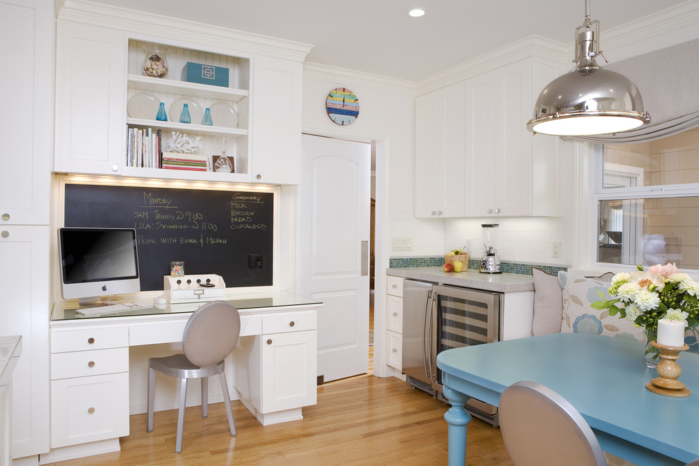 Example of a classic kitchen design in San Francisco with shaker cabinets, white cabinets, white backsplash, subway tile backsplash and stainless steel appliances