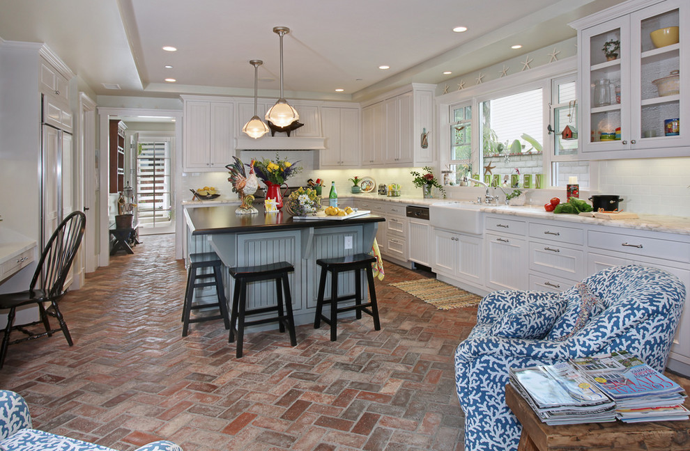 Inspiration for a coastal brick floor kitchen remodel in Orange County with a farmhouse sink