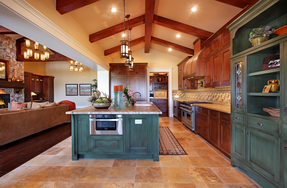 Inspiration for a large craftsman l-shaped ceramic tile and multicolored floor open concept kitchen remodel in San Diego with an undermount sink, recessed-panel cabinets, dark wood cabinets, multicolored backsplash, stainless steel appliances, granite countertops, ceramic backsplash and an island