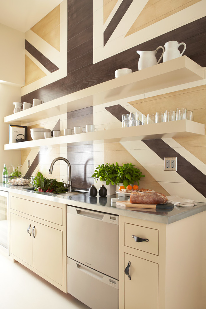 Example of a trendy kitchen design in San Francisco with an undermount sink, flat-panel cabinets, beige cabinets, stainless steel appliances and zinc countertops