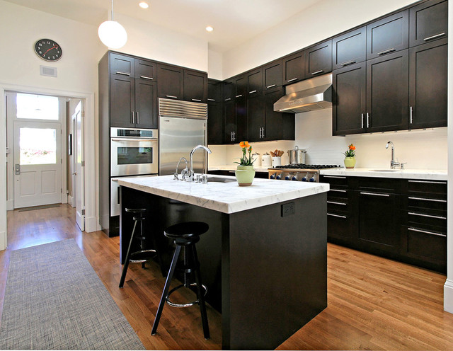 Kitchen - transitional kitchen idea in San Francisco with marble countertops, stainless steel appliances, shaker cabinets, dark wood cabinets and white backsplash