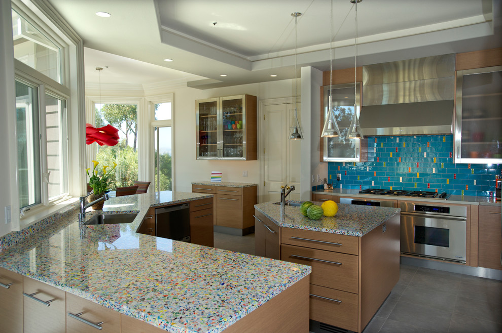 Trendy kitchen photo in San Francisco with recycled glass countertops, stainless steel appliances, flat-panel cabinets, medium tone wood cabinets and multicolored countertops