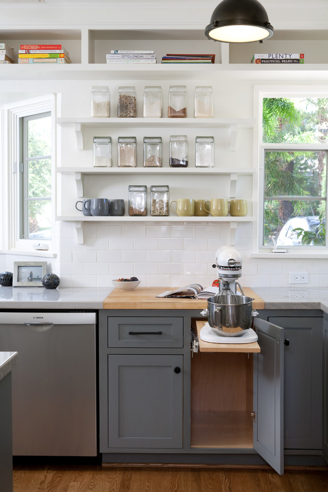 Inspiration for a large transitional medium tone wood floor kitchen remodel in Santa Barbara with shaker cabinets, gray cabinets, white backsplash, subway tile backsplash and stainless steel appliances